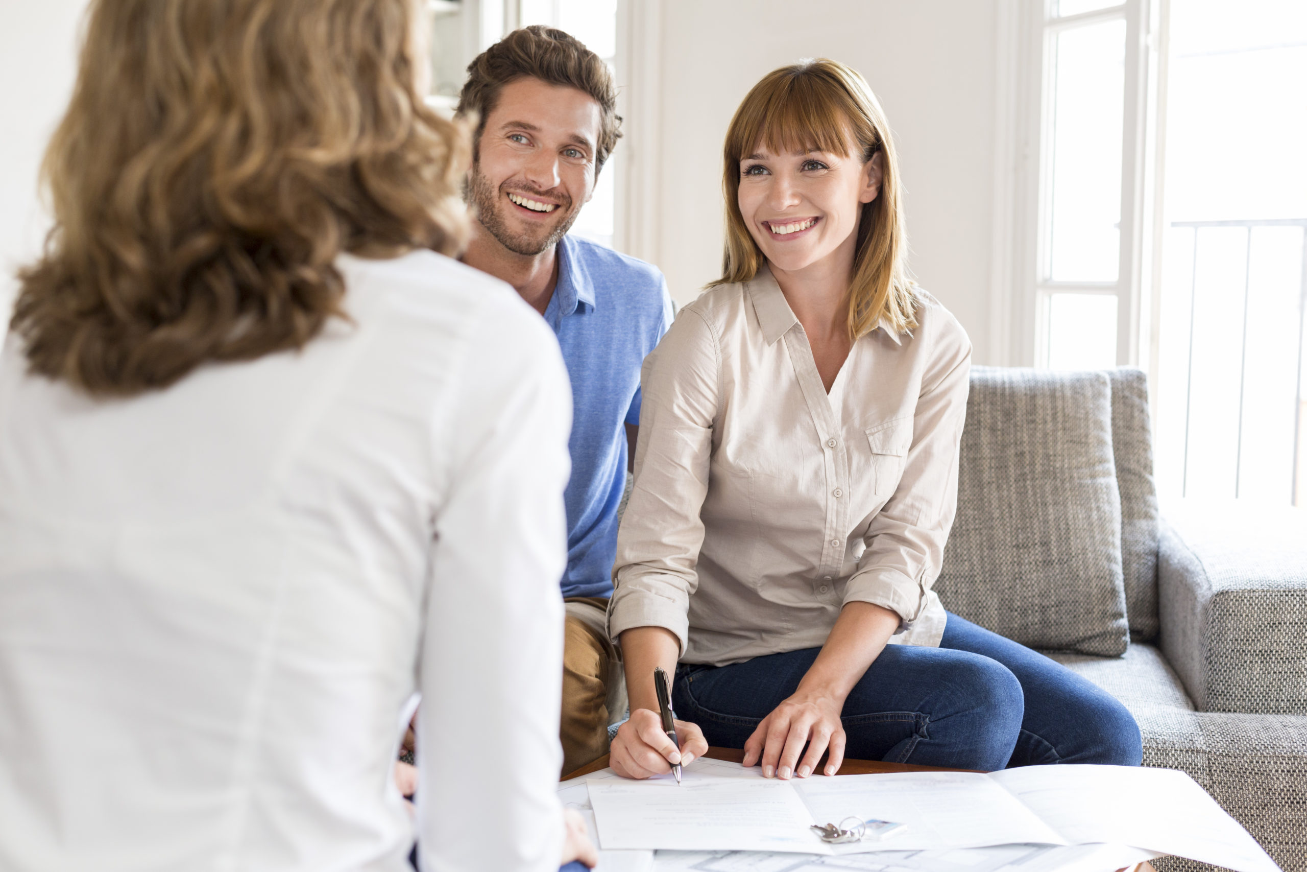Young couple owners meeting real estate agent for house investme